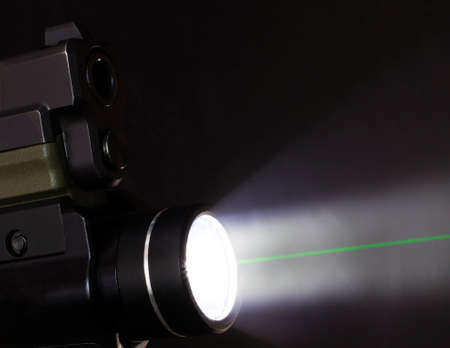 handgun mounted light with a green laser from within 版權商用圖片