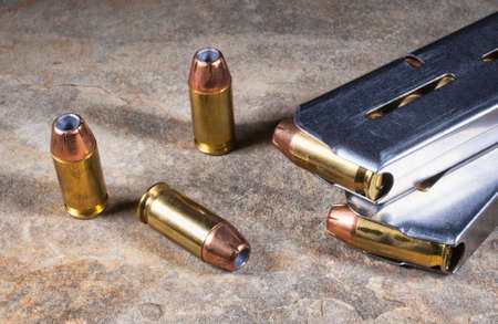 Bullets with hollow points for a handgun with magazines Stock Photo