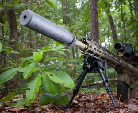 suppressor: Semi automatic firearm with a suppressor that is in the woods