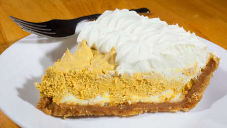 pumpkin pie: Pumpkin pie with whipped filling and white topping Stock Photo