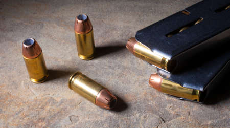 semi automatic: Cartridges with hollow point bullets and magazines for a semi automatic handgun