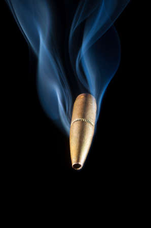 projectile: Bullet with copper coating and smoke coming close to the viewer
