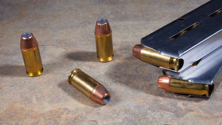 semi automatic: Hollow point ammunition and magazines for a semi automatic handgun