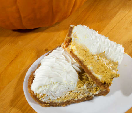 plage: Two huge pieces of whipped pumpkin pie on a white plage