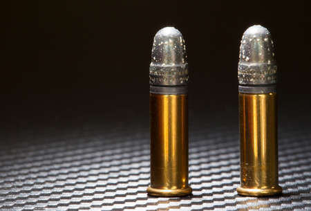 Lead bullets on rim fire ammo with white oxidation Stock Photo