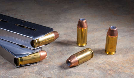 hollow: Cartridges for a semi automatic handgun loaded with hollow point bullets