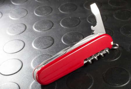 deployed: Bottle opener deployed on a mutli tool pocket knife Stock Photo