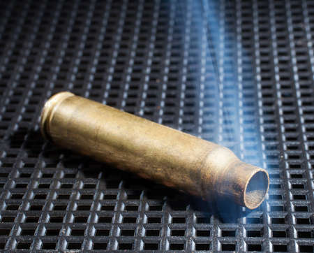 the casing: Rifle casing that has just been shot and is smoking