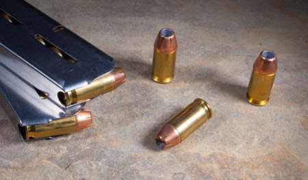 hollow: Ammunition with hollow point bullets and magazines for a handgun