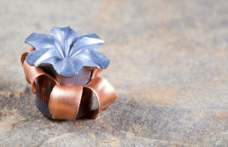 expanded: Expanded copper jacketed hollow point bullet after impact