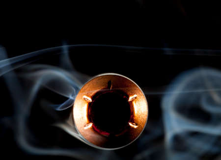 hollow: Copper plated hollow point bullet in the middle of smoke
