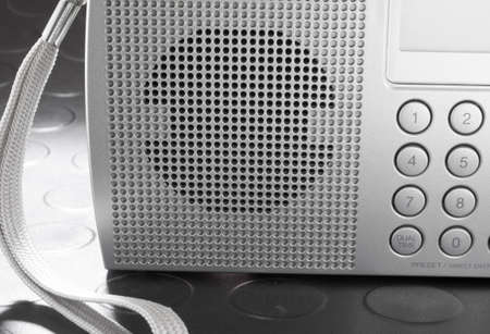shortwave: Speaker on the front of a portable shortwave radio