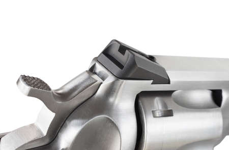notch: Rear sight on a revolver that has a black notch for shooting