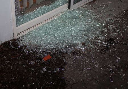 invader: Sliding glass door that has been shattered as a home invader tried to come into a house