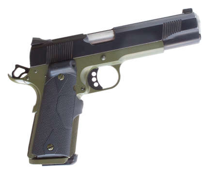 semi automatic: Isolated semi automatic handgun that has a green metal frame