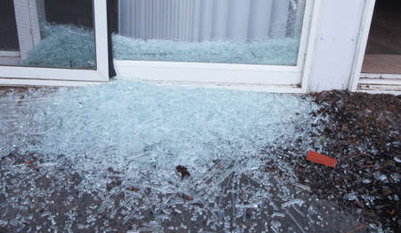 sliding: Sliding glass door that has been shattered by a criminal