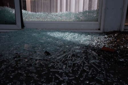 invader: Shattered sliding glass door after a home invader broke in