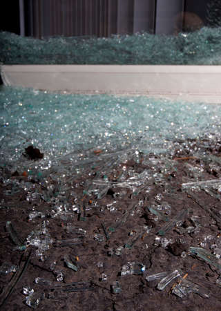 nightime: Glass shattered from a sliding glass door during a home invasion Stock Photo