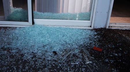 Sliding glass door that has been shattered by a burglar