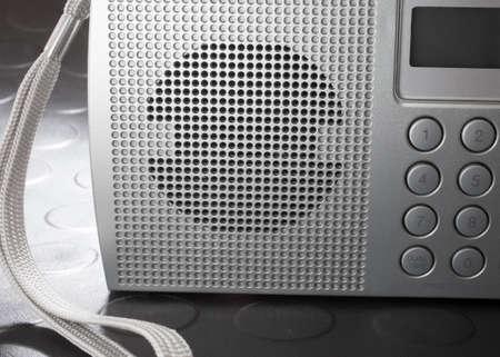 shortwave: Speaker on front of a portable shortwave radio that runs on batteries Stock Photo