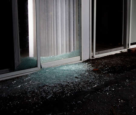 shattered glass: Shattered glass door after a burglar attempted to break in