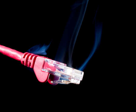 connector: Red network connector on a black background with smoke