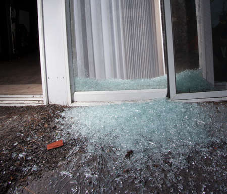 attempted: Sliding glass door in pieces after an attempted home invasion Stock Photo