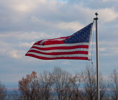 old glory: Wind blowing an American flag on the Blue Ridge of Virginia