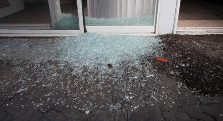 shattered glass: Shattered glass from a sliding door broken during a home invasion Stock Photo