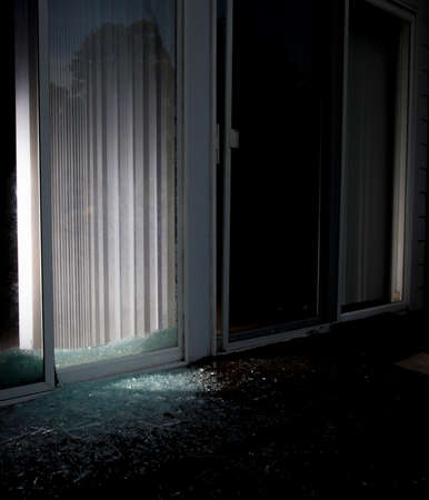 invaded: Sliding glass door shattered at a home invaded by criminals