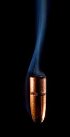 Copper colored lead bullet that looks like it is falling