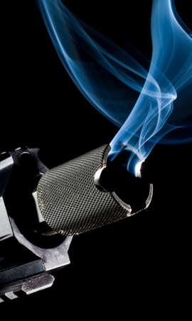 assault: Muzzle side of the barrel on an assault rifle smoking Stock Photo