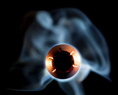 hollow: Copper jacketed hollow point and smoke coming at the camera