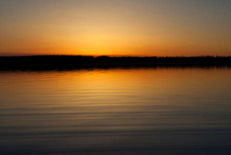 saskatchewan: After the sun has slipped below the horizon on a lake in Saskatchewan Canada Stock Photo
