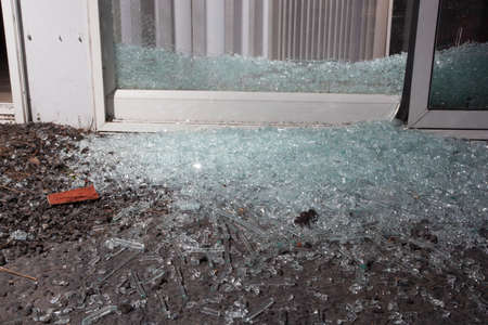 Glass from a shattered sliding glass door a home invader broke Stock Photo