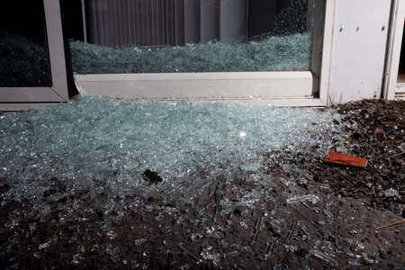 Glass Scattered From The Sliding Door Broken By A Home Invader Stock