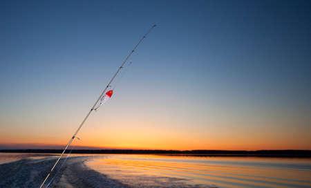 saskatchewan: Fishing lure and rod heading out on a lake in Saskatchewan Canada