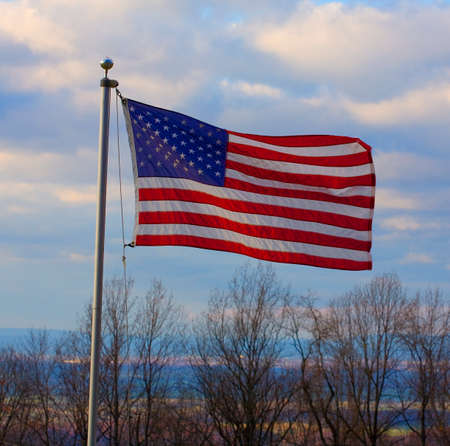 old glory: Stars and stripes flying high above the Shenandoah River Valley on the Blue Ridge Stock Photo