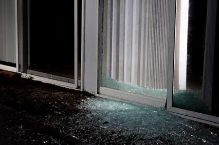 Shattered sliding glass door after an attempted home invasion