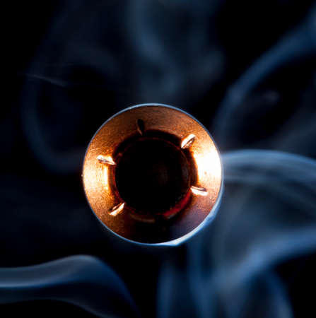 Large hollow point bullet with smoke heading at the camera