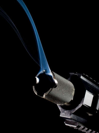 semi automatic: Semi automatic rifle on black with smoke coming from the barrel