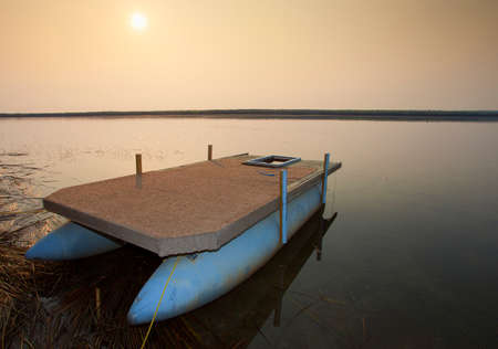 north end: Sun rising over a lake in the north end of Saskatchewan in Canada