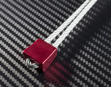 climbing cable: Red nut and wire that is used for recreational climbing