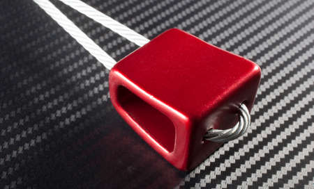 chock: Red nut that is used to protect recreational climbers