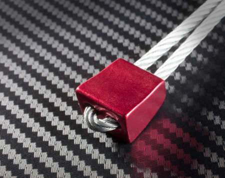 climbing cable: Small red nut that is used for protection when climbing