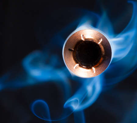 Hollow point bullet with smoke that looks like it will hit the camera