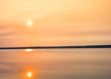 saskatchewan: Sun high above the water at sunrise in Saskatchewan Canada Stock Photo