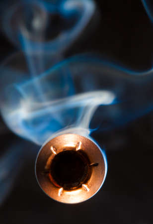 hollow: Copper plated bullet with a hollow point coming at the camera