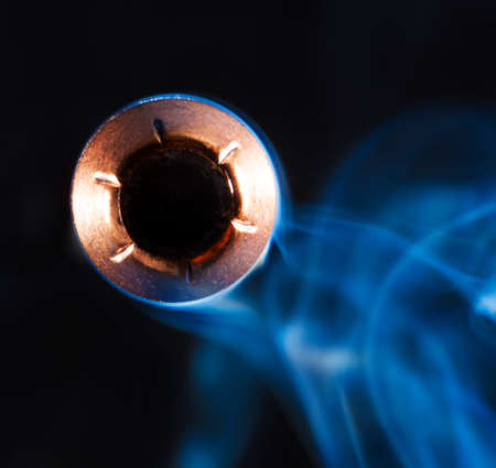 speed gun: Hollow point bullet and smoke that look like they are coming at the camera Stock Photo