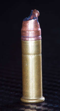 stovepipe: Bent bullet on top of a rimfire cartridge caused by a stovepipe in a firearm